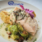 Poached Salmon with Brussels sprouts, artichoke hearts Francaise and lobster mashed potatoes.
